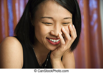 Happy laughing Asian woman.