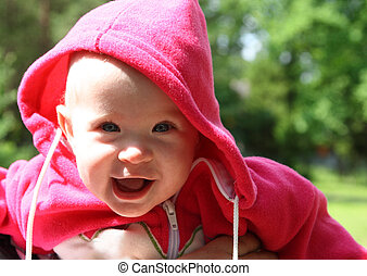 happy laughing baby outdoors