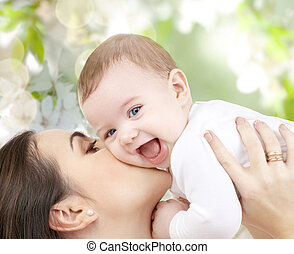 happy laughing baby playing with mother