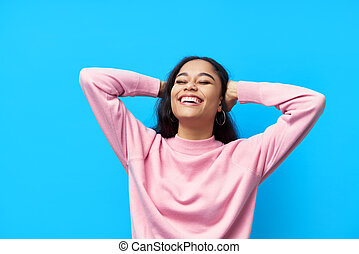 Happy laughing black woman on blue background
