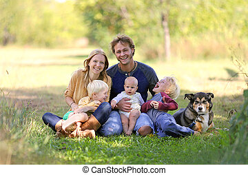 Happy Laughing Family of 5 People and Dog in Sunny Garden - ...
