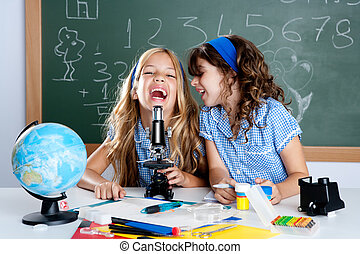 happy laughing kids student girls at school classroom