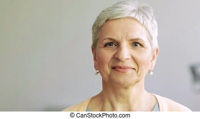 happy laughing senior woman face - people, emotion,...