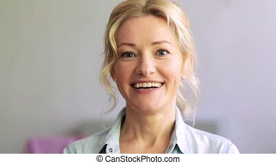 happy laughing woman face - people, emotion, expression and...