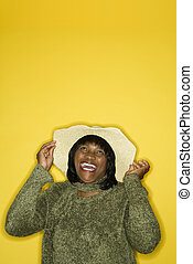 Happy laughing woman wearing hat.