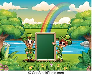 Happy leprechauns girl and boy holding a blank board for the message