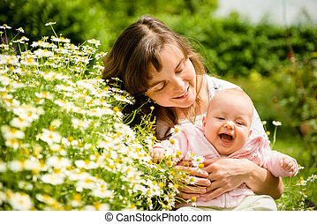 Happy life - mother with baby