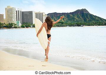 Happy lifestyle surf woman surfer in Waikiki beach