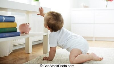 happy little baby crawling in living room at home -...
