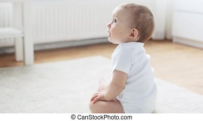 happy little baby crawling in living room at home 9