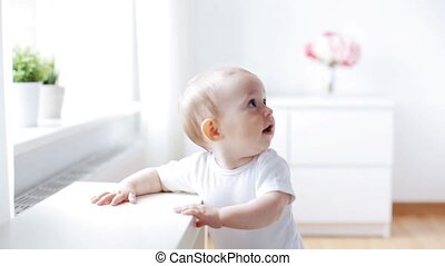 happy little baby crawling in living room at home 2
