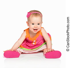happy little baby girl in bright multicolored festive dress ...