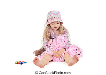 Happy little baby girl in pink tutu skirt and hat