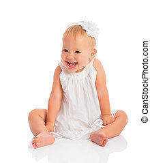 happy little baby girl in white dress laughs isolated on...