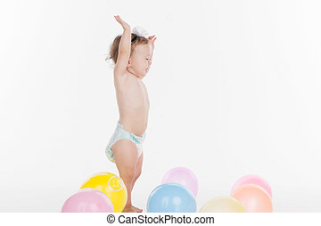 Happy little baby playing with balloons. Standing full...