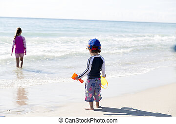 Happy Little Boy  And His Sister On The Beach
