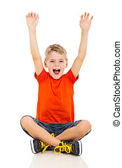 happy little boy sitting on floor and arms up