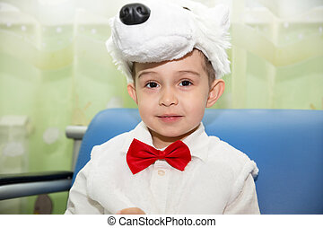 Happy little boy dressed as polar bear in New Year's holiday a children's holiday