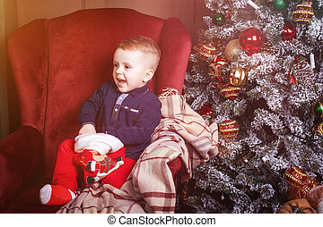 happy little boy holding a christmas stocking