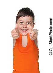 Happy little boy holds his thumbs up