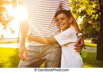 Happy little boy hugging his dad