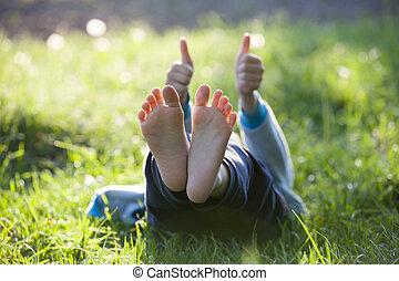 Happy little boy in green grass