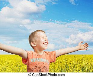 Happy little boy on a summer day