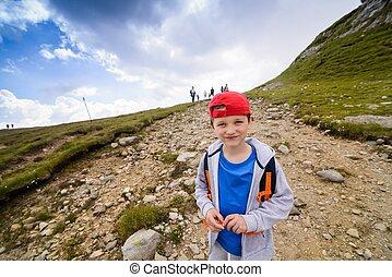 Happy little boy on mountain track