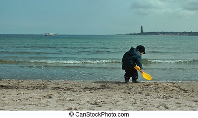 Happy little boy on the beach