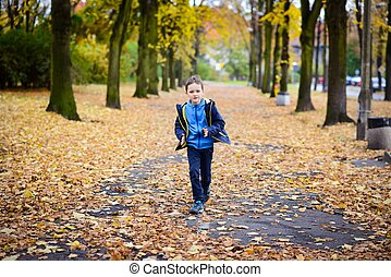 Happy little boy running