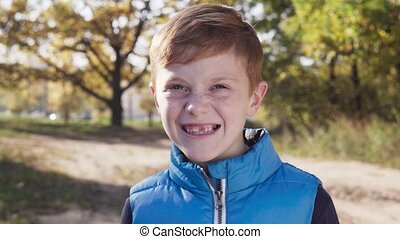 Happy little boy smiling without front primary tooth on ...