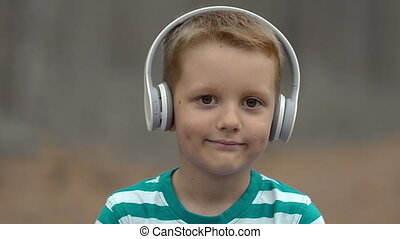 Happy Little Boy With Headphones