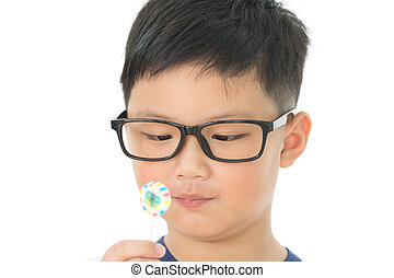 Happy little boy with lollipop isolated on white background