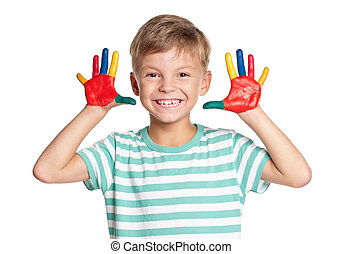 Happy little boy with paints on hands