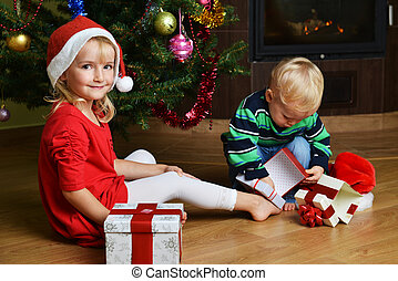 boy with sister - happy little boy with sister near...