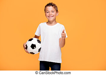 Happy little boy with soccer ball.
