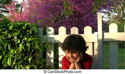 Happy little boy's day dreaming