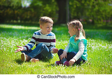 Happy little brother and sister playing
