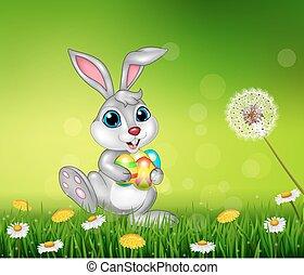 Happy little bunny holding eggs