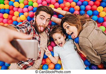 Happy little child have fun with his parents