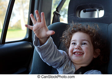 Happy  little  child travel in a car sit