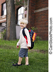 Happy Little Child with his backpack on his first day or Preschool