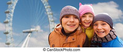 happy little children faces over ferry wheel - childhood,...
