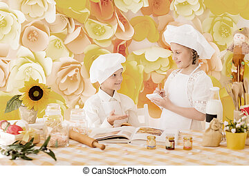 happy little children in the form of a chef to prepare delicious meals