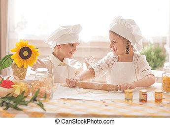 happy little children in the form of a chef to prepare delicious