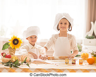 happy little children in the form of a chef to cook  delicious meal