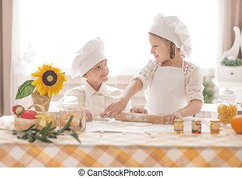 happy little children in the form of chef to prepare delicious