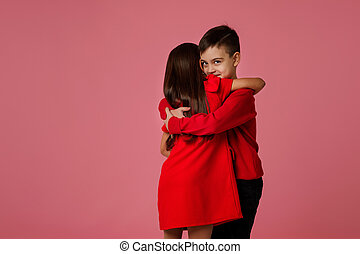 child girl and boy with gift box hugging