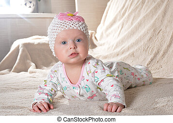 happy little cute baby girl in a dress and with flower...