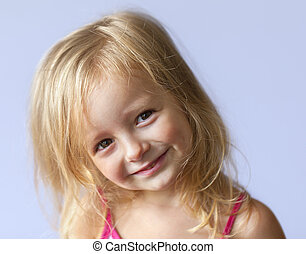 happy little girl a on gray background